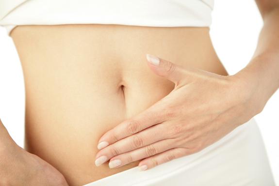 woman-hand-abdomen-120226